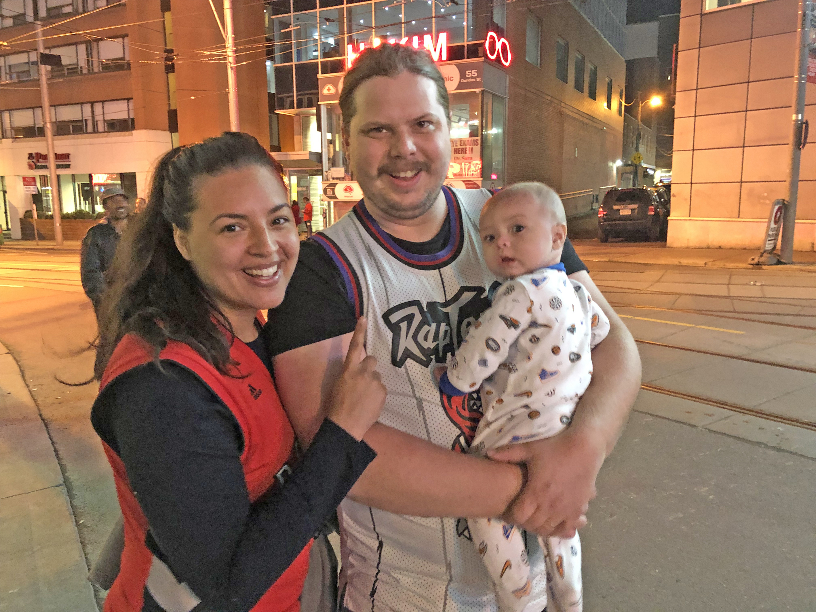It might have been 1am, but this young couple were making sure their infant son could grow up to say 'I was there' when Toronto came out to celebrate