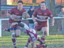 Young Trojans battle to cup loss