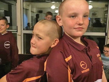 Moor players shave heads for charity