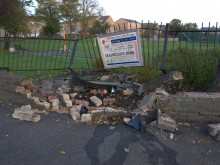 Car smashed into park wall
