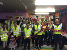 MP cuts tinsel ribbon on group's new home