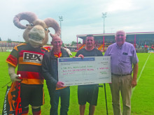 Rams fan presents cheque to Benevolent Fund
