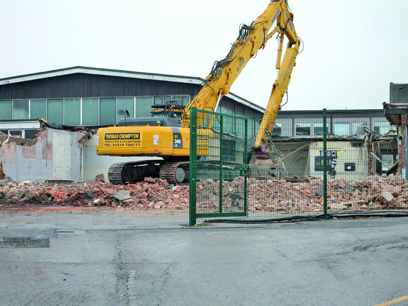 Demolition crews move in to flatten school buildings