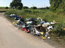Fly-tippers collected rubbish for free and dumped it ... now their van is on the tip!