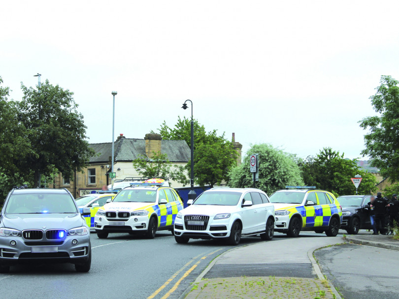 Two held by armed police in swoop on town centre
