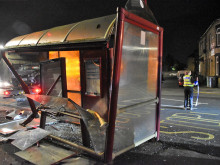 Near miss for pair as car hits bus shelter