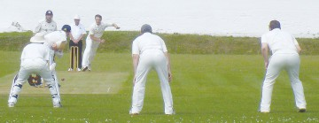 ON THE FRONT FOOT: Spen's Rob Burton, bowling, is the Bradford League's leading wicket taker