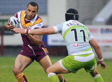 Batley full-back Miles Greenwood seeks a way past Sheffield's Michael Knowles